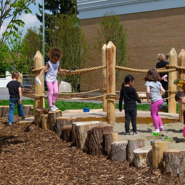 kids – sand play walking on the stump border 7